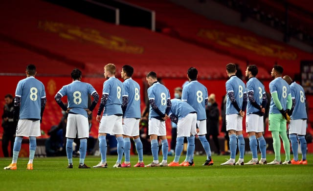 Manchester City players line up in retro number eight shirts in memory of Colin Bell