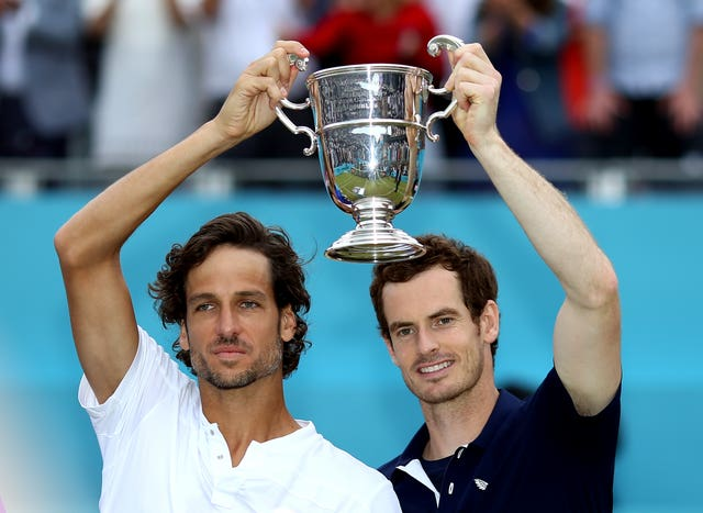 Andy Murray (right) and Feliciano Lopez (left) hold up the doubles trophy at Queen's Club