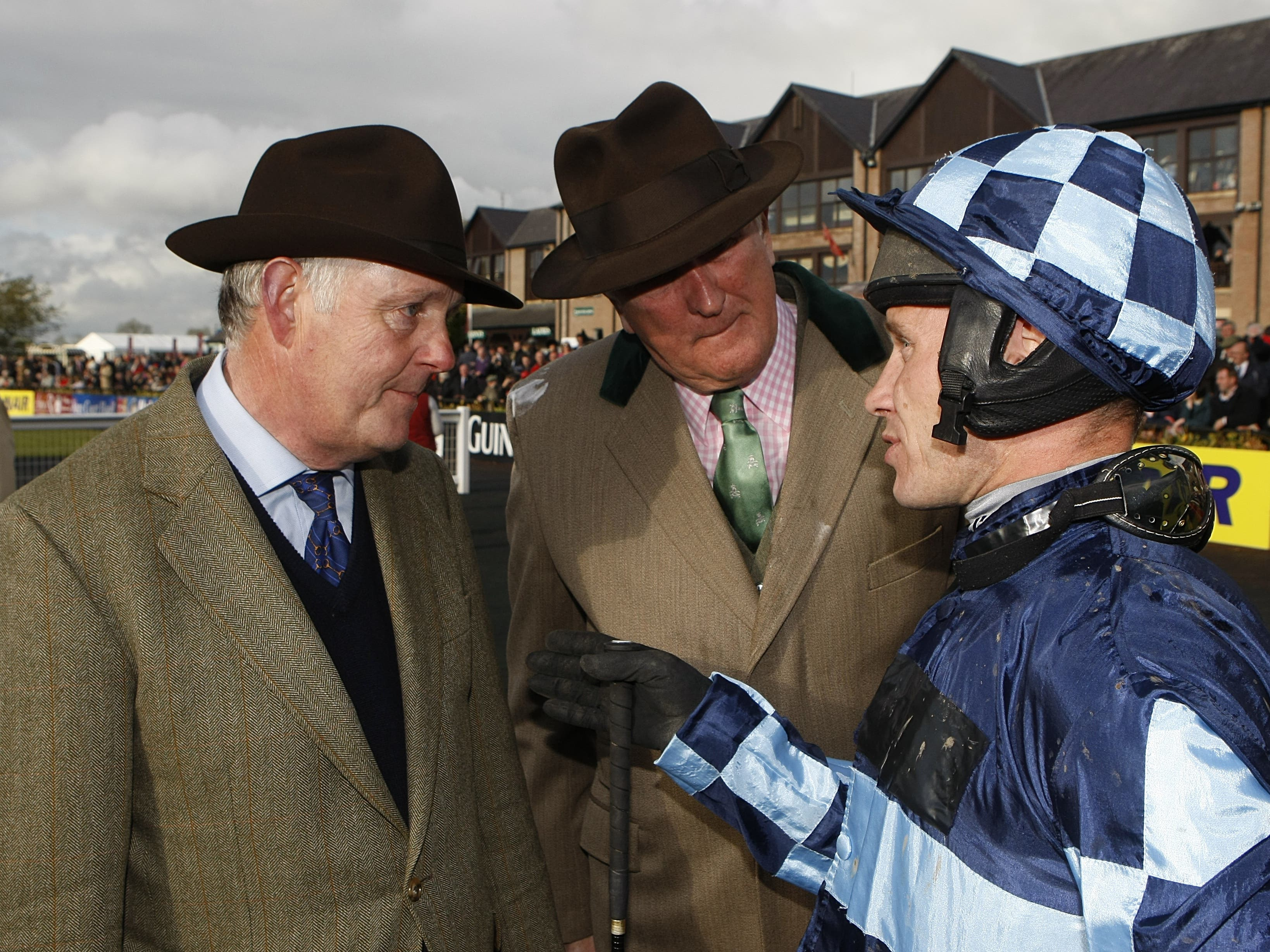 Richard Johnson (right) chats to trainer Philip Hobbs (left) (Julien Behal/PA)