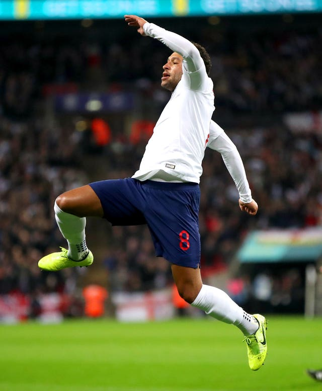 Alex Oxlade-Chamberlain celebrates scoring England's opener