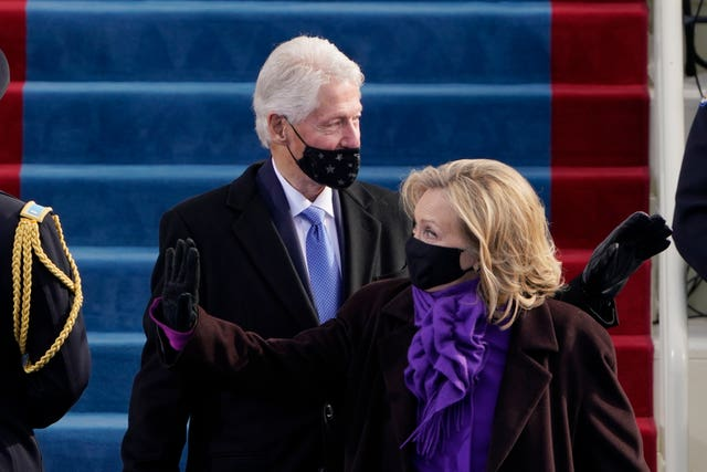 Former president Bill Clinton and his wife, former secretary of state Hillary Clinton, arrive