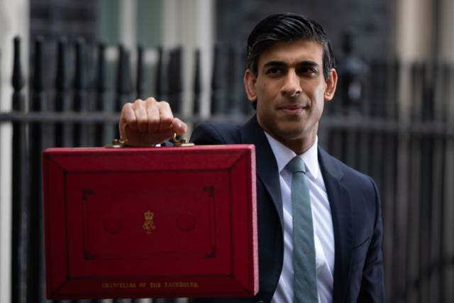 Rishi Sunak holding up the red box before the 2021 Budget