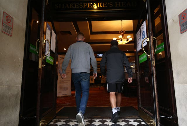 Customers walk into reopened pub