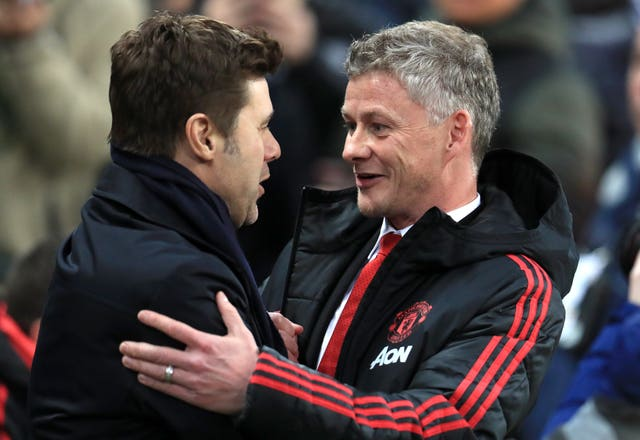 Mauricio Pochettino, left, was reported to be a target for Manchester United before the appointment of Ole Gunnar Solskjaer