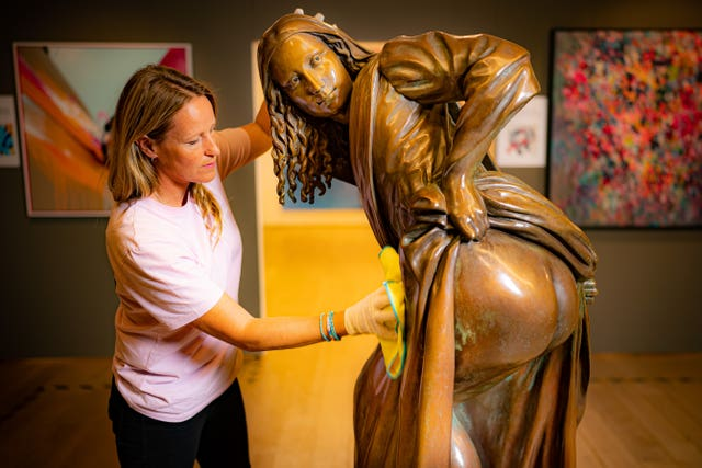 The life-size bronze artwork is based on the painting by street artist Nick Walker (Ben Birchall/PA)