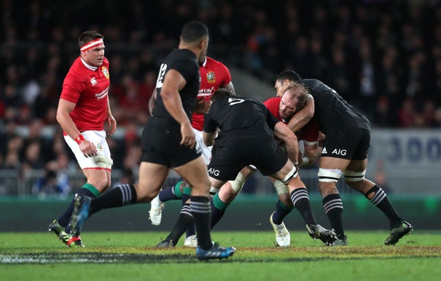 Alun Wyn Jones is tackled by New Zealand's Sam Whitelock and Jerome Kaino