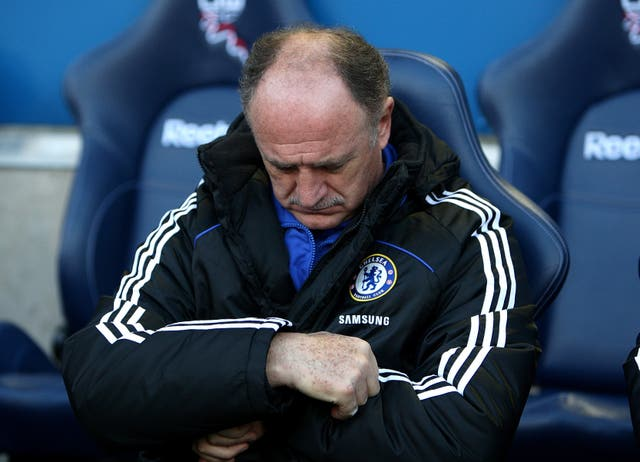 Luiz Felipe Scolari checks his watch as Chelsea take on Bolton