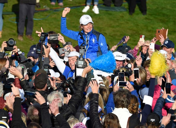 Europe Solheim Cup captain Catriona Matthew is held aloft on the 18th green