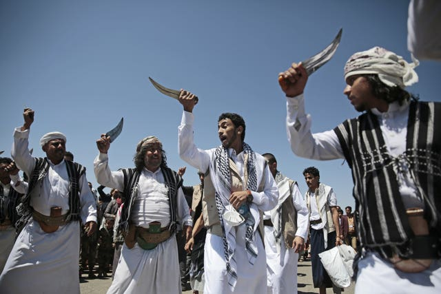 A Yemeni prisoner, centre, performs a traditional dance (Hani Mohammed/AP)