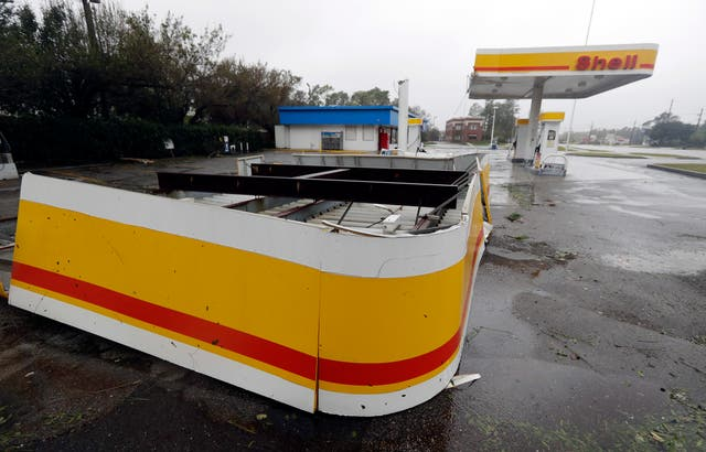 The shelter of a petrol station lies on the ground in Wilmington