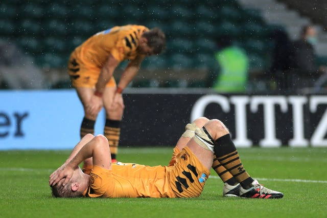 Wasps' Joe Launchbury appears dejected with team-mates after the final whistle in October