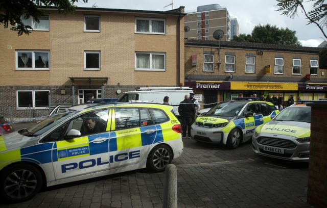 Police officers in Tower Hamlets after a man suffered stab injuries (Yui Mok/PA Wire)