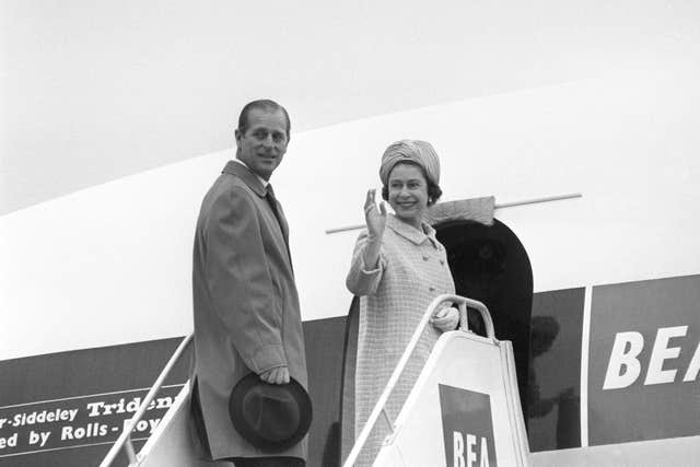 The Queen and the Duke of Edinburgh board their Trident airliner of British European Airways at Heathrow Airport, on their way to Malta for a four-day visit (PA)