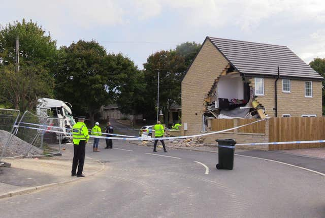A police cordon in Barnsley, where a house has been left severely damaged after being hit by a lorry