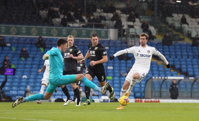 Burnley keeper Nick Pope concedes a penalty for a challenge on Leeds striker Patrick Bamford