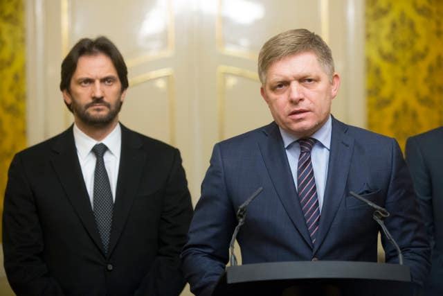 Slovak Prime Minister Robert Fico, right, gives a media statement, with Minister of Interior Robert Kalinak, left (Bundas Engler/AP)