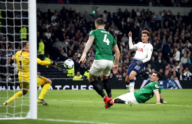 Mat Ryan, left, saves from Dele Alli, second right