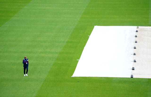 Ben Stokes surveys the sodden outfield at Emirates Old Trafford.