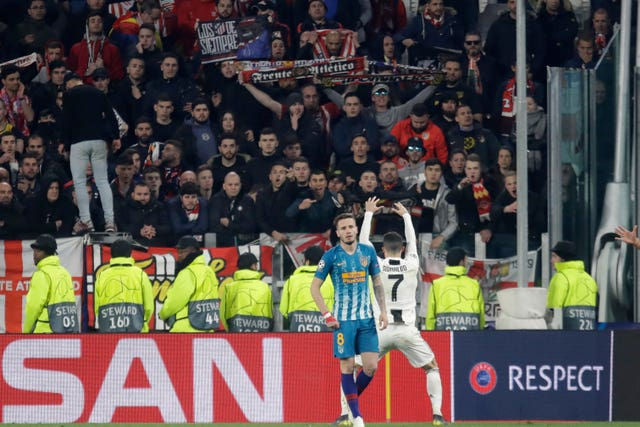 Cristiano Ronaldo celebrates in front of Atletico fans