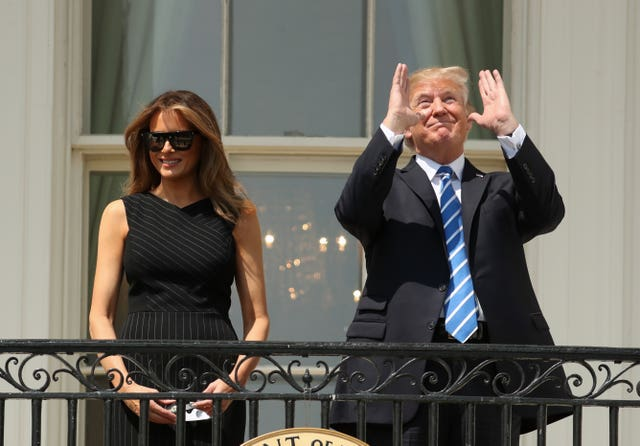 Trump looks at the eclipse without any eye protection (Andrew Harnik/AP)