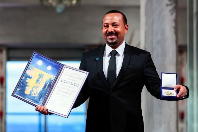 Ethiopia's Prime Minister Abiy Ahmed poses for the media after receiving the Nobel Peace Prize