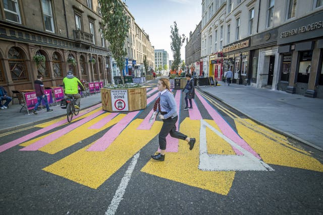 The changing face of the high street. The newly-pedestrianised Union Street in Dundee in Scotland, a previously busy city centre thoroughfare, has been painted with a colourful zebra crossing-style mural to encourage people to explore the street, some six months on from the evening of March 23 when Prime Minister Boris Johnson announced nationwide restrictions