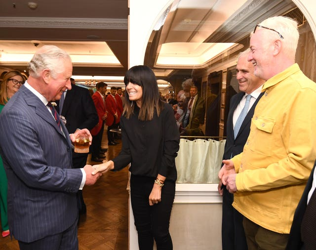 The Prince of Wales shakes hands with Claudia Winkleman