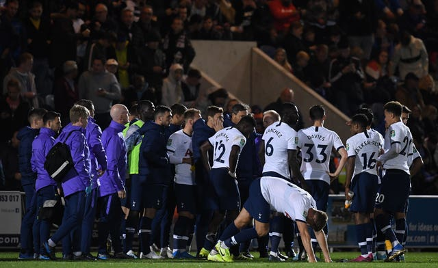 Pochettino speaks to his player ahead of the penalty shoot-out at Colchester