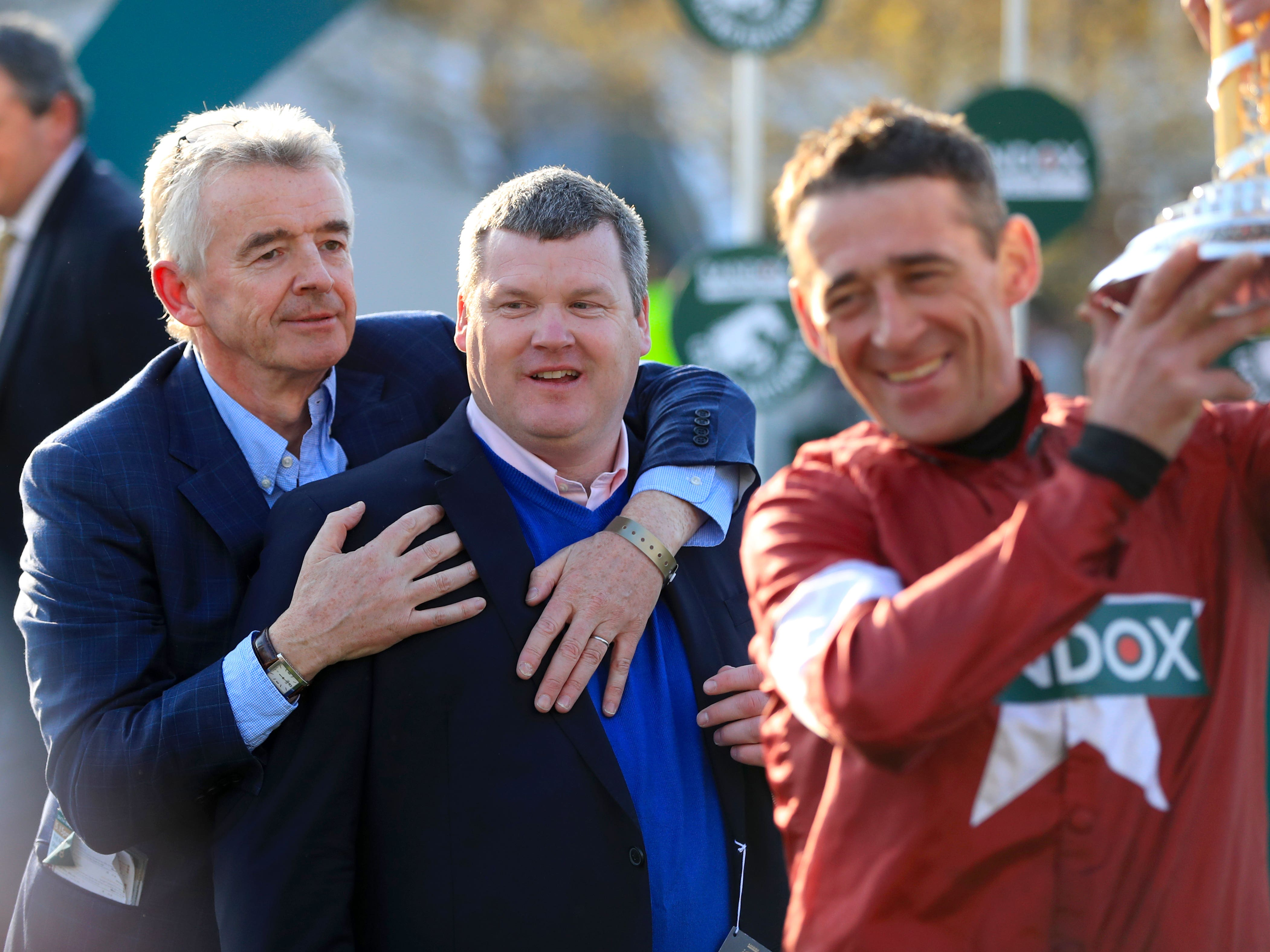 Michael O'Leary with trainer Gordon Elliott and jockey Davy Russell (Mike Egerton/PA)