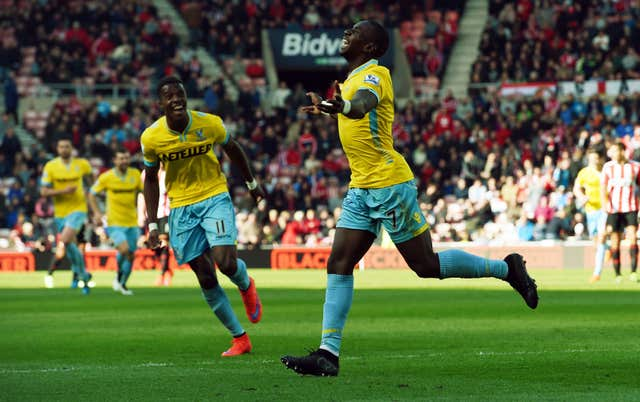 Yannick Bolasie, right, celebrates scoring a hat-trick at Sunderland with Crystal Palace team-mate Wilfried Zaha