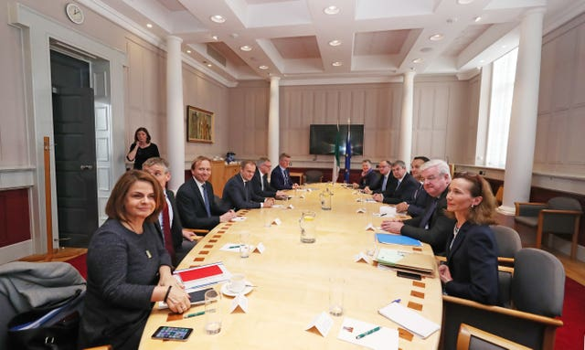Donald Tusk, fourth left, and Leo Varadkar, third right, at Government Buildings in Dublin