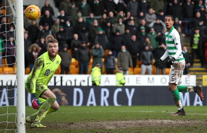 Christopher Jullien watches on as Ryan Christie's free-kick finds the net