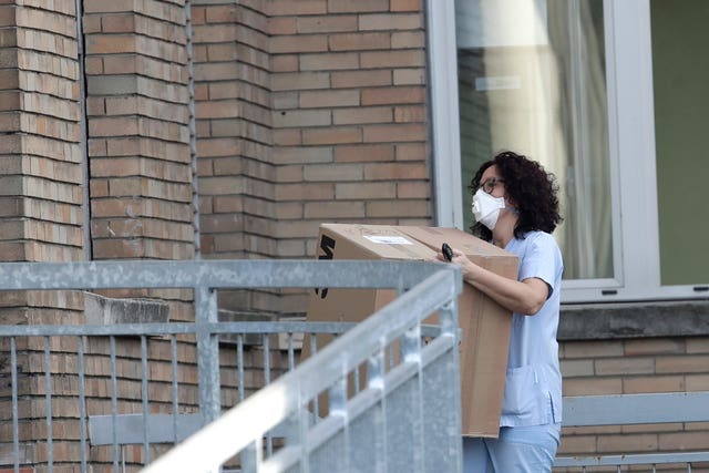 A nurse carries a box into the hospital of Codogno, near Lodi in northern Italy