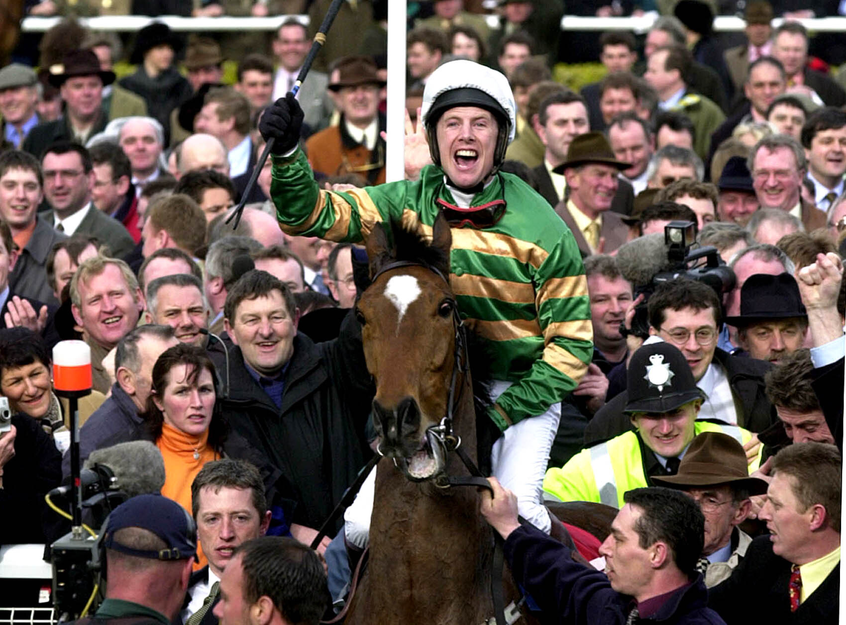 Charlie Swan and Istabraq after winning a third Champion Hurdle at Cheltenham