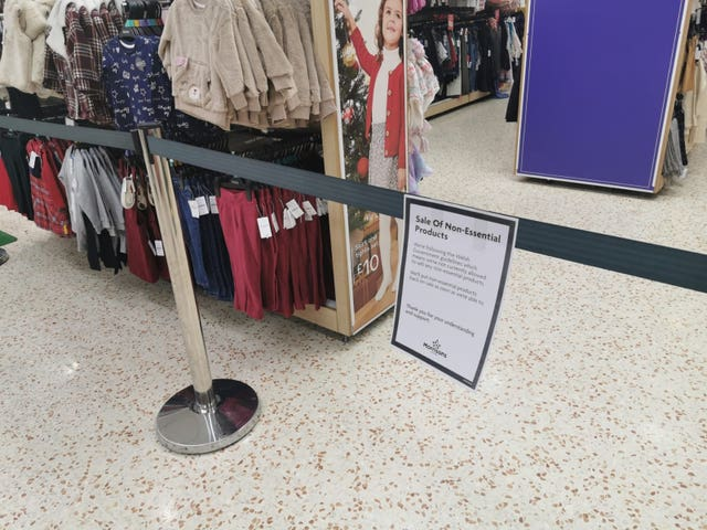 A notice informing customers of the sales of non-essential products in a Morrison's store in Cardiff Bay, Wales