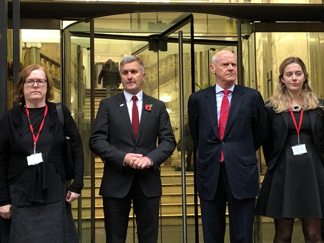 Dr Richard Freeman (second left) stands with his defence team outside the building in Manchester where the long-running hearing is taking place