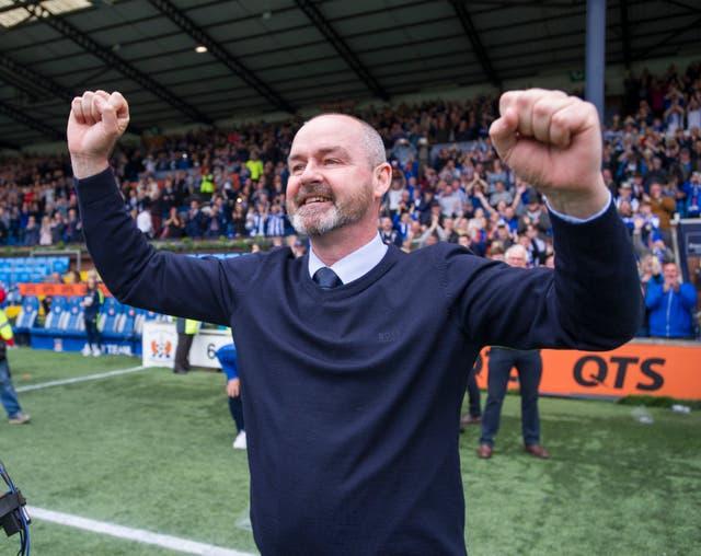 Kilmarnock manager Steve Clarke celebrates after his team secured third place