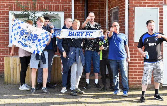 Bury fans gather at Gigg Lane