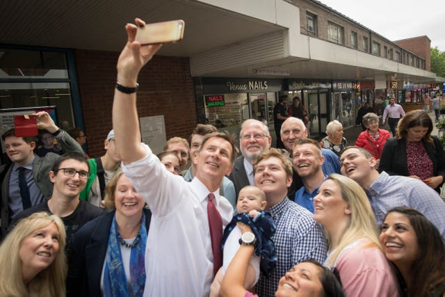 Conservative Party leadership candidate Jeremy Hunt takes a selfie with supporters during a visit to Chelmsford town centre in Essex
