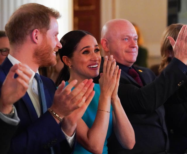 The Duke and Duchess of Sussex cheer during a marriage proposal at the Endeavour Fund Awards at Mansion House in London