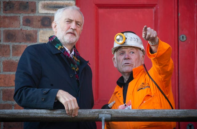 Labour leader Jeremy Corbyn meets former miner John Kane, aged 82, during a visit to the National Mining Museum at the former Lady Victoria Colliery, Newtongrange