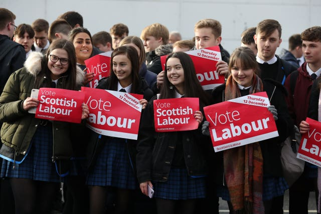 Young Labour supporters wait for Jeremy Corbyn, to visit Sainsbury's in Hamilton, Lanarkshire