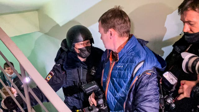 Police at the apartment where Oleg Navalny lives in Moscow