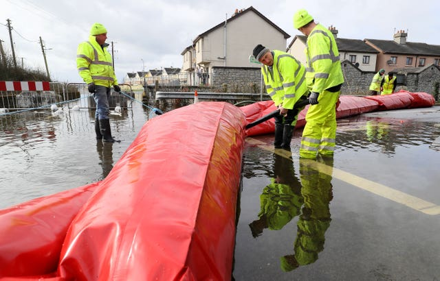 Members of Westmeath County Council install an inflatable aqua dam in Athlone, Co Westmeath