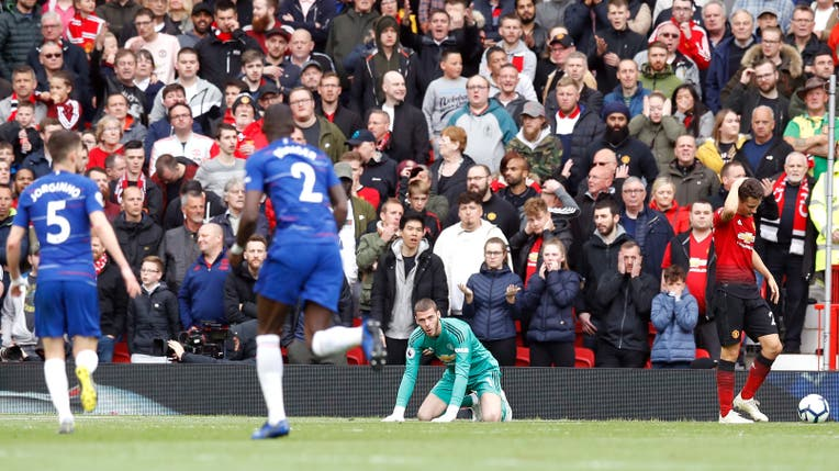 Manchester United goalkeeper David de Gea sits dejected after Chelsea's Marcos Alonso (not pictured) scores his side's first goal of the game during the Premier League match at Old Trafford, Manchester