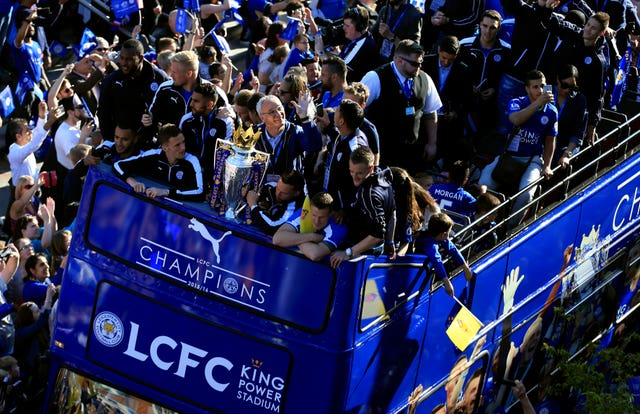 Leicester manager Claudio Ranieri, centre, clutches the Premier League trophy during an open top bus parade at the end of a fairytale 2015-16 season. The Foxes, who were almost relegated the previous year, defied odds of 5,000/1 to be crowned champions in one of the most remarkable and unlikely triumphs in the history of team sport