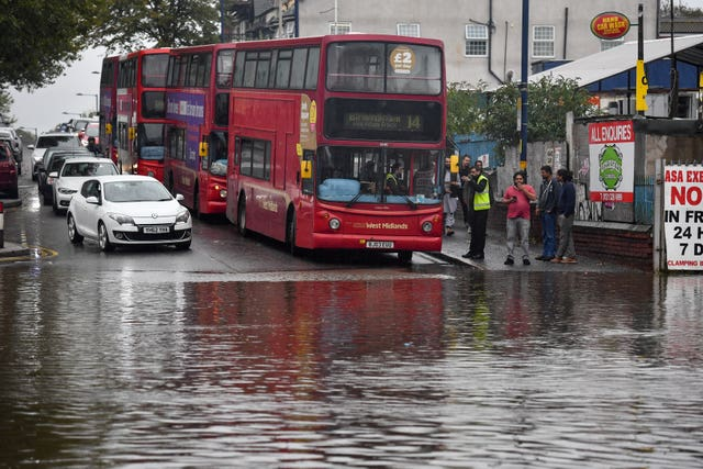 Flash flooding is causing more problems for travellers on the roads and railways