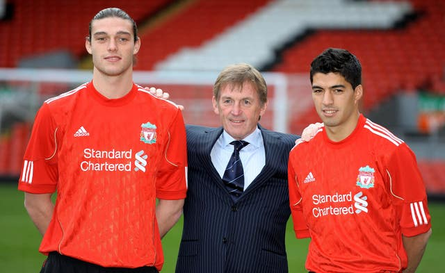 Andy Carroll (left) and Luis Suarez (right) with manager Kenny Dalglish