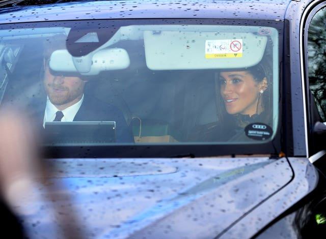 The Duke and Duchess of Sussex arrive for the festive lunch. Aaron Chown/PA Wire