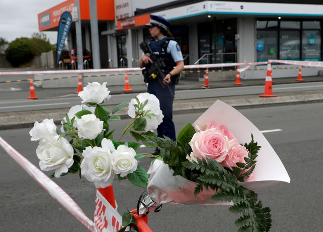A police officer stands at a police cordon near the Linwood Mosque in Christchurch